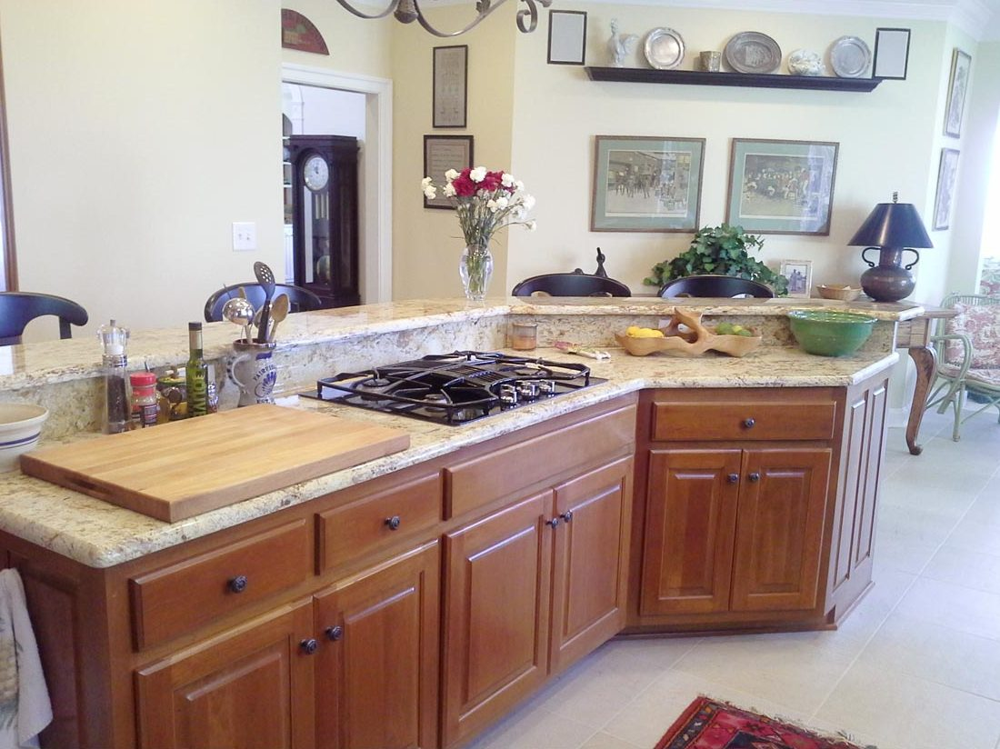 remodeled kitchen with chefs island and marble countertops